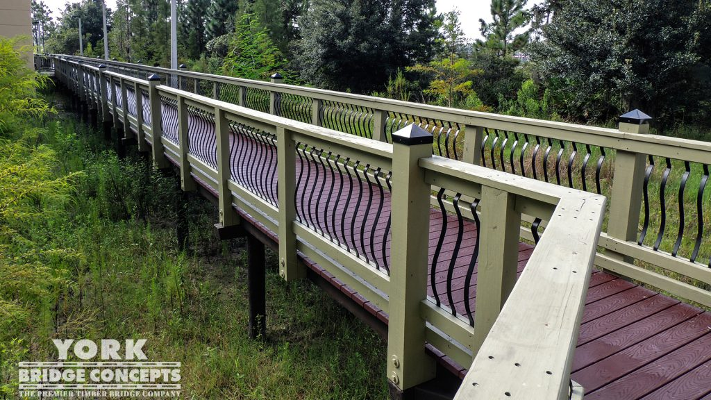 Pasco-Hernando State College Pedestrian Bridge – Wesley Chapel, FL | York Bridge Concepts - Timber Bridge Builders