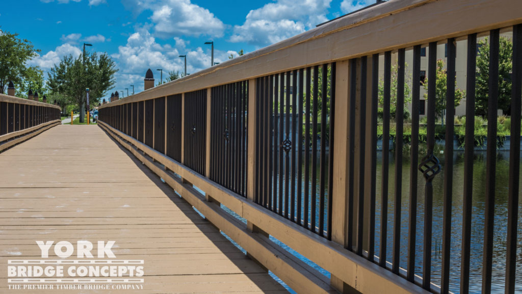 Ave Maria University Pedestrian Bridge - Ave Maria, FL | York Bridge Concepts - Timber Bridge Builders