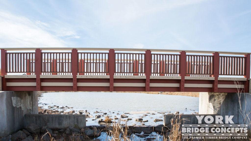 Dulles South Multipurpose Center Pedestrian Bridge - Fairfax, VA | York Bridge Concepts - Timber Bridge Builders